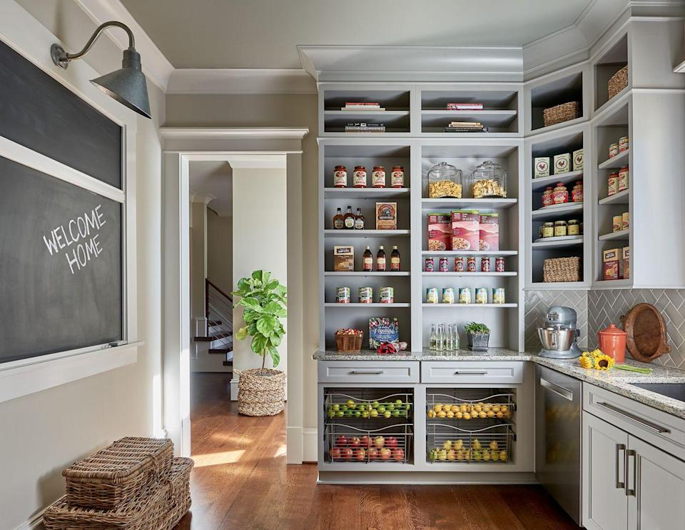 "<p>If you're lucky enough to have a walk-in pantry—or even a pantry closet—taking an afternoon to reassess your household's needs and reorganize this space can do wonders. And if it's large enough, this could be a great place to sneak in an extra workspace away from a common area.</p><p>""When it comes to pantry design, think about what works for your family in a day-to-day scenario,"" says Cary, North Carolina-based designer <a href=""http://www.southernstudio.com/style-and-source/"" rel=""nofollow noopener"" target=""_blank"" data-ylk=""slk:Vicky Serany"" class=""link rapid-noclick-resp"">Vicky Serany</a>. ""Consider your family's top priorities and then determine how you can work them into the overall design. Think about options such as open shelving, an extra dishwasher or sink, and an 'organization station' for notes and to-do lists to keep the family centered. Also, an efficiently organized pantry allows a dedicated space for small appliances, which in-turn creates more counter space.""</p>"