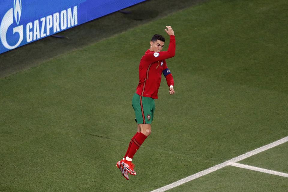 Portugal's Cristiano Ronaldo celebrates after scoring on a penalty kick during the Euro 2020 soccer championship group F match between Portugal and France at the Ferenc Puskas stadium in Budapest, Hungary, Wednesday, June 23, 2021. (AP Photo/Laszlo Balogh, Pool)