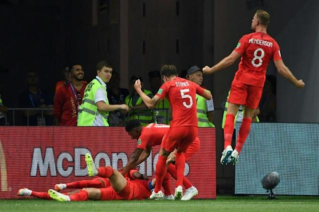 England players celebrate their second goal during the Russia 2018 World Cup Group G football match between Tunisia and England at the Volgograd Arena in Volgograd on June 18, 2018