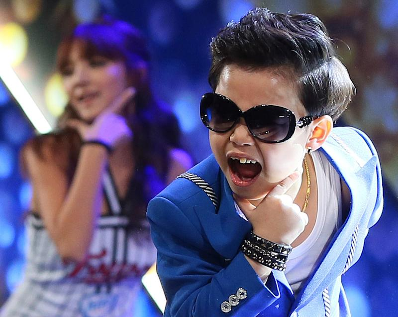 """In this Wednesday, Dec. 12, 2012 photo. South Korean Hwang Min-woo, the 7-year-old nicknamed """"Little PSY,"""" performs during a concert in Seoul, South Korea. Hwang on Wednesday, March. 6, 2013, said that he wanted to gain global fame like his """"big brother,"""" PSY during his press conference. (AP Photo/Yonhap, Han Jong Chan)  KOREA OUT"""