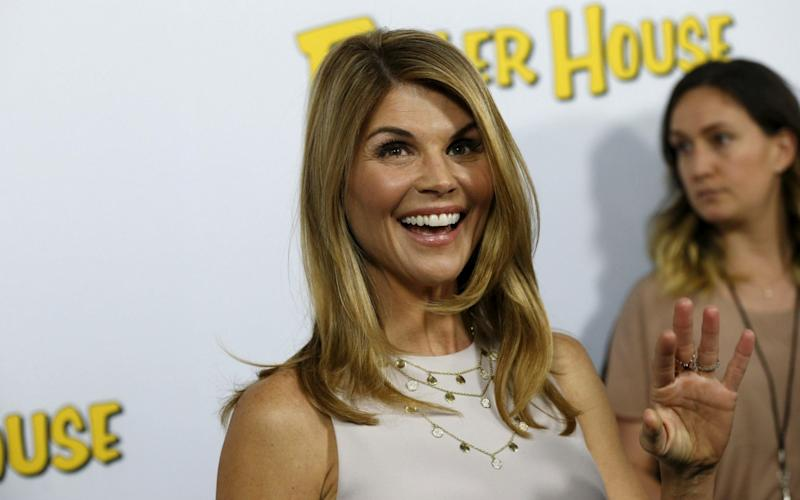 Lori Loughlin, star of 90210 and Full House, was arrested on Wednesday - REUTERS