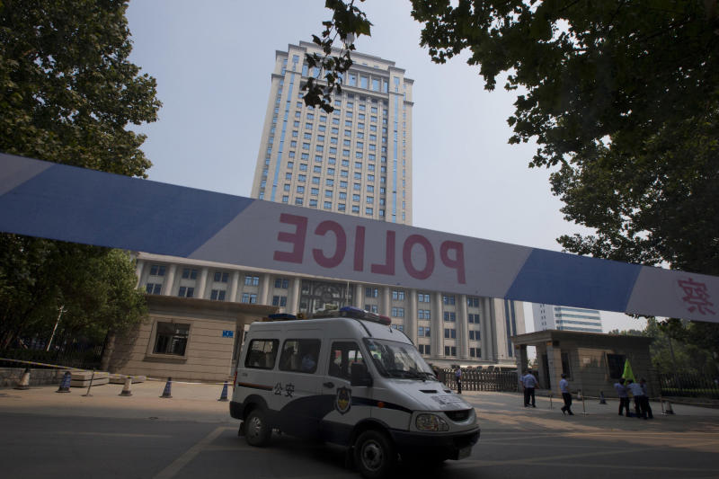A police van drives past the Jinan Intermediate People's Court in Jinan, eastern China's Shandong province on Friday, Aug. 23, 2013. Former Chinese politician Bo Xilai's trial on charges of bribery, embezzlement and abuse of power enters its second day. (AP Photo/Ng Han Guan)