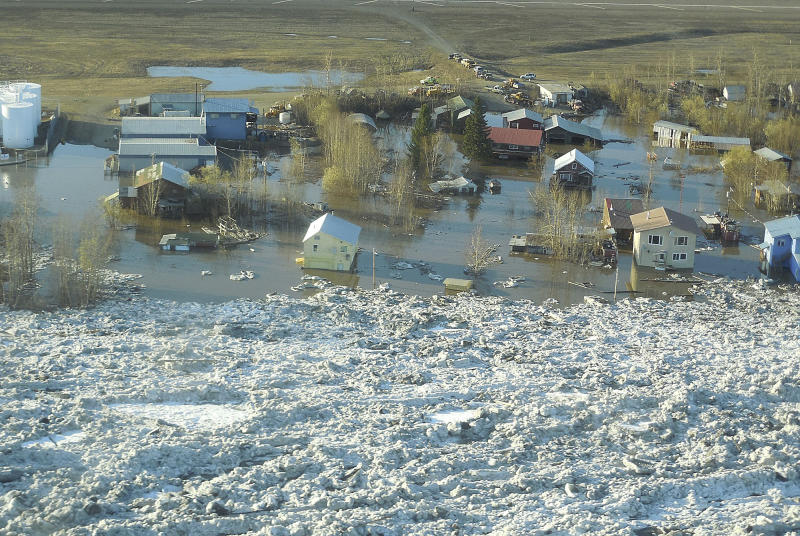 In this May 27, 2013 photo released by the National Weather Service, ice and water are shown flooding homes and other buildings in Galena, Alaska. Several hundred people are estimated to have fled the community of Galena in Alaska's interior, where a river ice jam has caused major flooding, sending water washing over roads and submerging buildings. (AP Photo/National Weather Service, Ed Plumb)