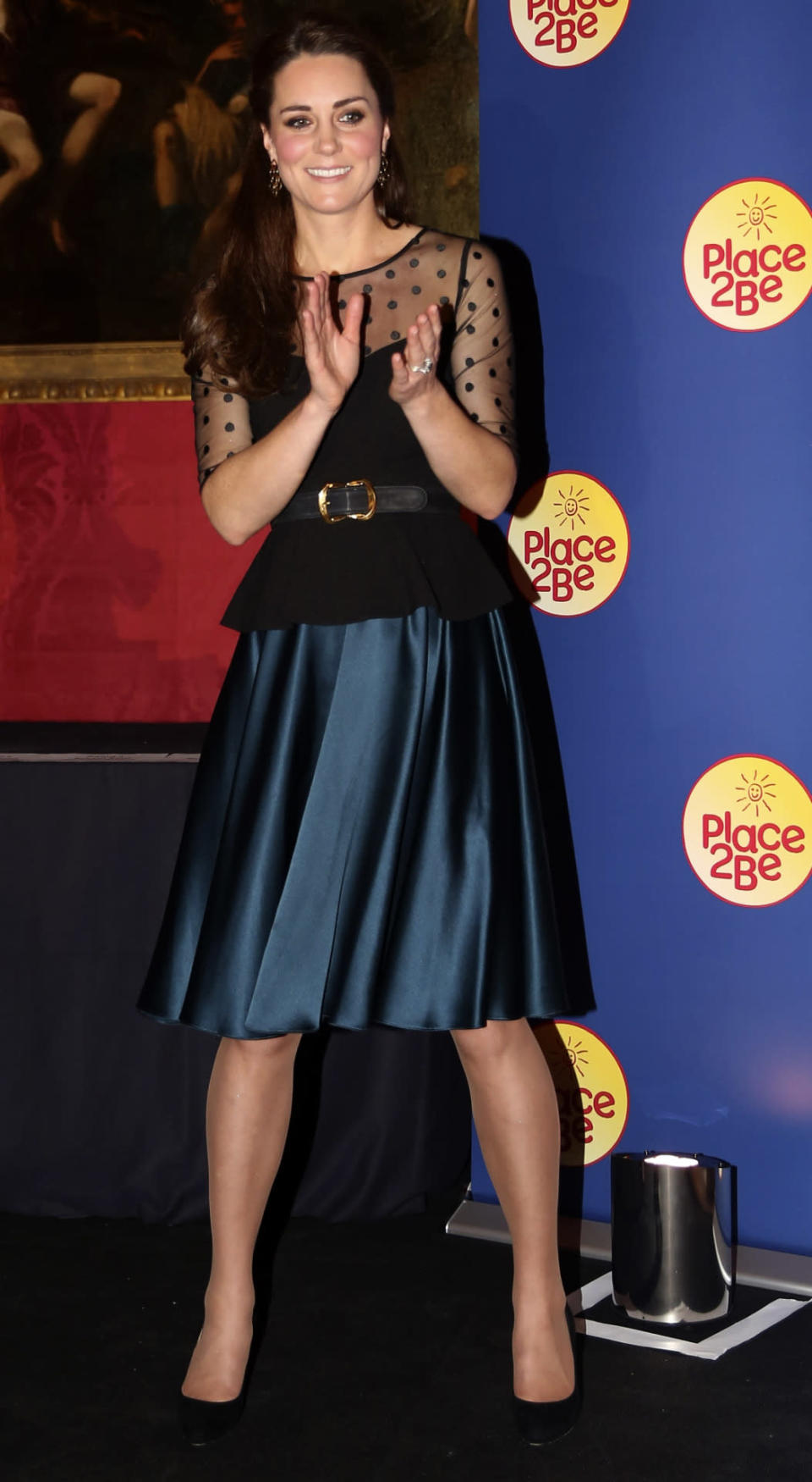 <p>Kate mixed designer and the high street for an awards ceremony at Kensington Palace. Wearing a polka dot top from Hobbs with a petrol blue Jenny Packham skirt, the Duchess accessorised with an Alexander McQueen belt and Jimmy Choo pumps. </p><p><i>[Photo: PA]</i></p>