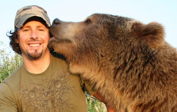 "Naturalist Casey Anderson and his adopted bear Brutus. Brutus was the best ""man"" at Anderson's wedding."