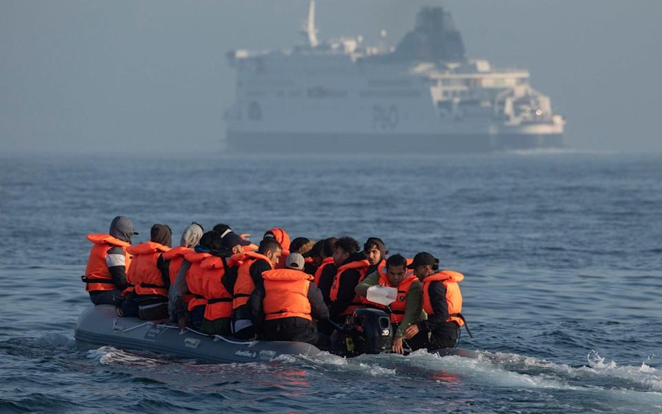 An inflatable boat carrying migrant men, women and children crosses a shipping lane in the English Channel this week - Dan Kitwood/Getty Images