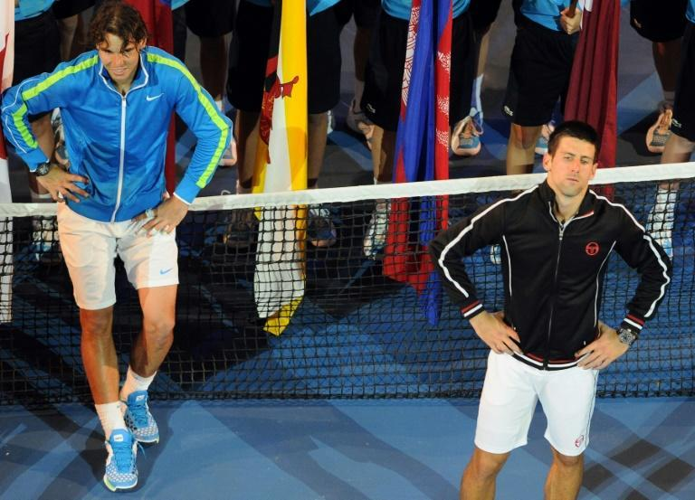 An exhausted Novak Djokovic, right, and Rafael Nadal, left, wait for the trophy presentations after their marathon 5hr 53min 2012 final