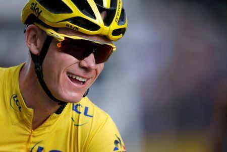 FILE PHOTO: Cycling - Tour de France cycling race - The 113-km (70,4 miles) Stage 21 from Chantilly to Paris, France, July 24, 2017. Yellow jersey leader Team Sky rider Chris Froome of Britain celebrates on the finish line.    REUTERS/Jean-Paul Pelissier/File Photo
