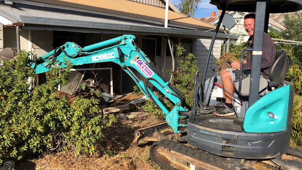 Malcolm and Garry Taylor demolishing their late mother's home in Murtoa, Victoria.