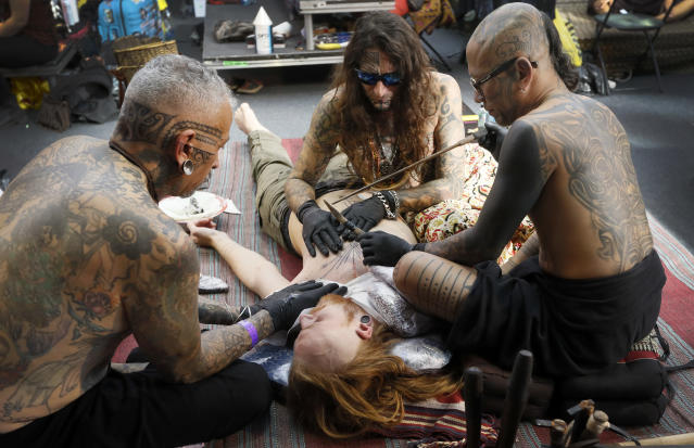 <p>A man gets a tattoo using a traditional hand-tapping method at The International Tattoo Convention in London, Friday, Sept. 22, 2017. (Photo: Kirsty Wigglesworth/AP) </p>