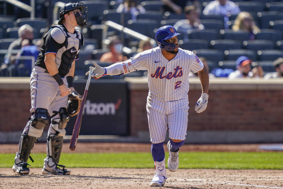 New York Mets' Dominic Smith hits an RBI sacrifice fly off Miami Marlins relief pitcher Ross Detwiler during the fifth inning of a baseball game, Thursday, April 8, 2021, in New York. (AP Photo/John Minchillo)