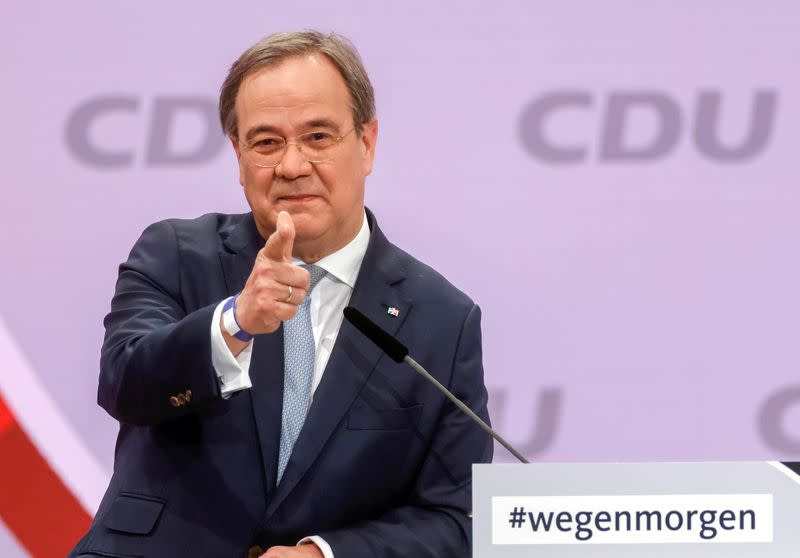 FILE PHOTO: Armin Laschet, the new leader of Germany's Christian Democratic Union, gestures as he delivers a speech to a CDU conference in Berlin