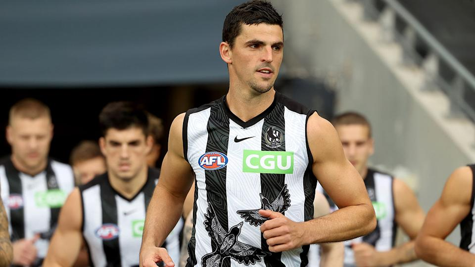 Seen here, Scott Pendlebury leads out his Collingwood teammates for an AFL game.