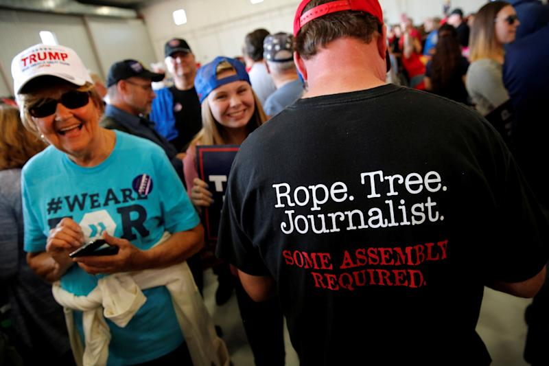 """A man wears a shirt reading """"Rope. Tree. Journalist."""" as supporters gather to rally with Republican presidential nominee Donald Trump in a cargo hangar at Minneapolis Saint Paul International Airport in Minneapolis, Minnesota, U.S. November 6, 2016. REUTERS/Jonathan Ernst TPX IMAGES OF THE DAY"""