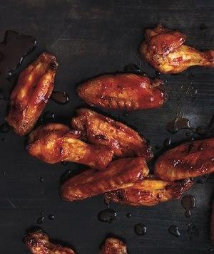 """<p>Hot wings at home? You bet. The oven ensures crispy results, with only 5 minutes of prep and fewer calories than deep-fried, sports-bar hot wings. And the cherry on top of this hot wings recipe is that it features another universal crowd pleaser: Sriracha.</p> <p> <strong>Get the recipe:</strong> <a href=""""http://www.realsimple.com/food-recipes/browse-all-recipes/crispy-oven-baked-wings-sriracha-honey-glaze"""" target=""""_blank"""">Crispy Oven-Baked Wings with Sriracha-Honey Glaze</a></p>"""