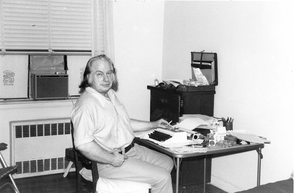 Author L Ron Hubbard poses for a portrait with a typewriter at a desk on January 10, 1982 in New York City, New York