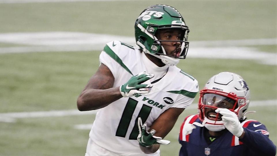 Jan 3, 2021; Foxborough, Massachusetts, USA; New York Jets wide receiver Denzel Mims (11) goes up for a catch over New England Patriots cornerback Joejuan Williams (33) during the first half at Gillette Stadium. Mandatory Credit: Winslow Townson-USA TODAY Sports