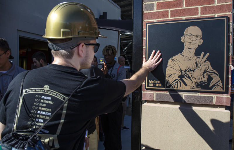 WEST LAFAYETTE, IN - SEPTEMBER 07: A Purdue Boilermakers student fan touches the plaque of Tyler Trent while entering the newly unveiled Tyler Trent Student Gate at Ross-Ade Stadium before the game against the Vanderbilt Commodores on September 7, 2019 in West Lafayette, Indiana. (Photo by Michael Hickey/Getty Images)