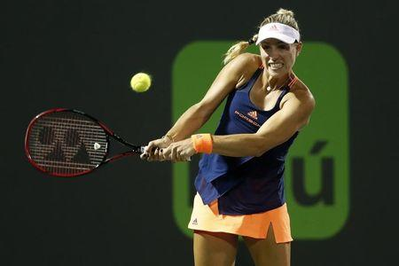 Mar 29, 2017; Miami, FL, USA; Angelique Kerber of Germany hits a backhand against Venus Williams of the United States (not pictured) on day nine of the 2017 Miami Open at Crandon Park Tennis Center. Williams won 7-5, 6-3. Mandatory Credit: Geoff Burke-USA TODAY Sports
