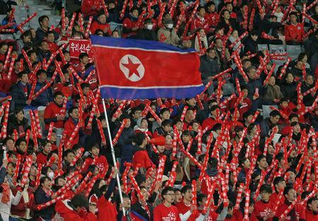 Soccer Football - East Asian Football Championship - North Korea v Japan - Ajinomoto Stadium, Tokyo, Japan - December 9, 2017. North Korean soccer team fans are seen in the stands. REUTERS/Toru Hanai