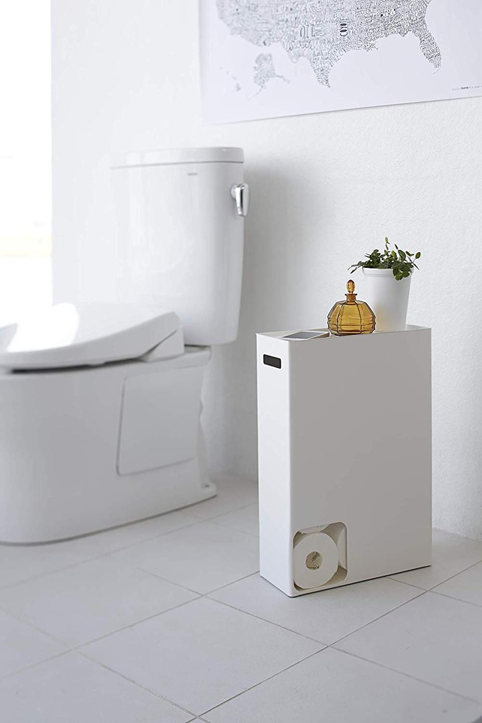 """<h3><a href=""""https://www.amazon.com/YAMAZAKI-home-Plate-Toilet-Stocker/dp/B00N1G23MS"""" rel=""""nofollow noopener"""" target=""""_blank"""" data-ylk=""""slk:Yamazaki Toilet Paper Stocker"""" class=""""link rapid-noclick-resp"""">Yamazaki Toilet Paper Stocker</a></h3><br>Stock it with toilet paper, then top it off with decorative items like a plant or a candle. It's the perfect small-space storage solution for tiny bathrooms. <br><br><strong>Yamazaki</strong> Toilet Paper Stocker, $, available at <a href=""""https://www.amazon.com/YAMAZAKI-home-Plate-Toilet-Stocker/dp/B00N1G23MS"""" rel=""""nofollow noopener"""" target=""""_blank"""" data-ylk=""""slk:Amazon"""" class=""""link rapid-noclick-resp"""">Amazon</a>"""