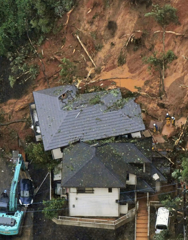 <p>Workers search for missing person at the site of a landslide caused by a heavy rain in Kitakyushu, southern Japan Friday, July 6, 2018. (Photo: Kyodo News via AP) </p>