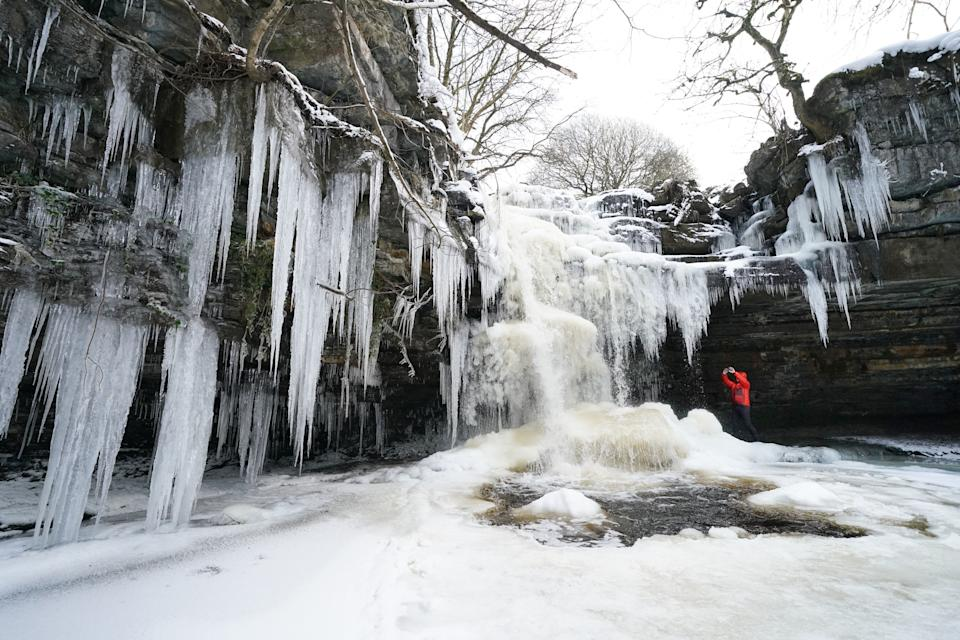 Icicles at Summerhill Force and Gibson's Cave in Teesdale after temperatures plunged to below minus 22C overnight, the lowest in the UK in more than two decades. Picture date: Thursday February 11, 2021.