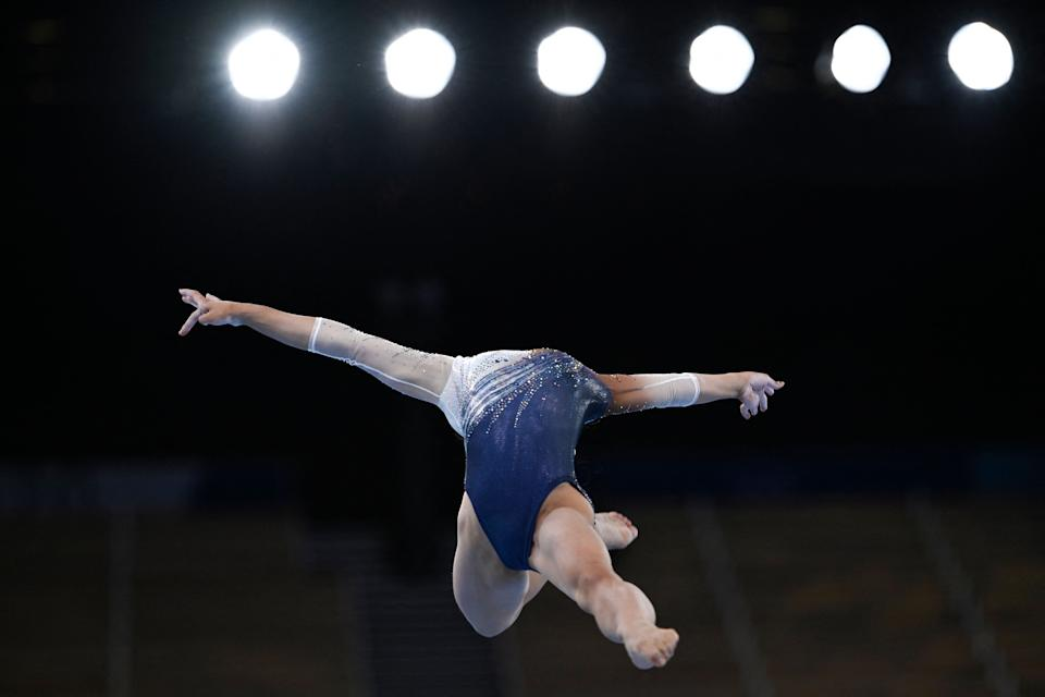 <p>Japan's Urara Ashikawa competes in the artistic gymnastics balance beam event of the women's qualification during the Tokyo 2020 Olympic Games at the Ariake Gymnastics Centre in Tokyo on July 25, 2021. (Photo by Loic VENANCE / AFP)</p>