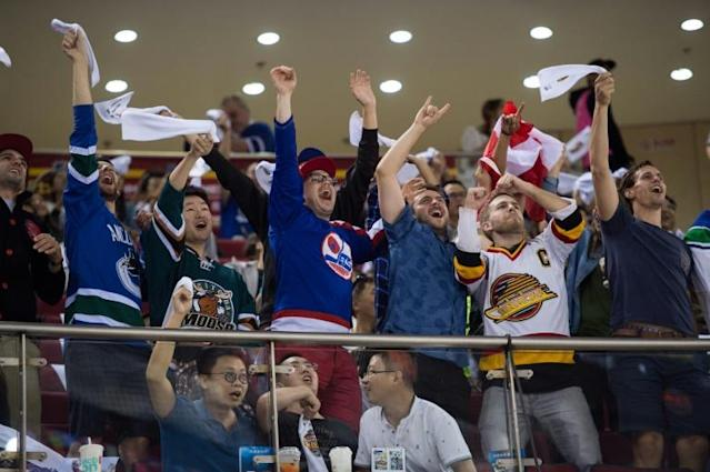 Fans in Beijing cheer the NHL's Vancouver Canucks at the 2017 NHL China Games, with the NHL saying they hope to return for pre-season games in 2020 and possibly have NHL talent in the 2022 Beijing Winter Olympics (AFP Photo/NICOLAS ASFOURI)