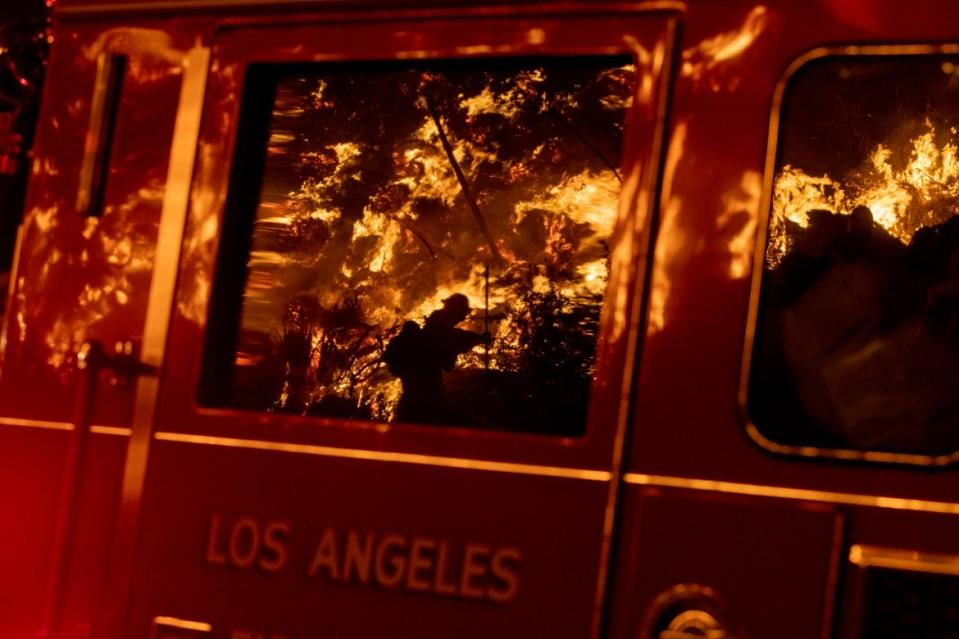 "<div class=""inline-image__caption""><p>Flames are reflected on a LA City fire truck on Sepulveda Blvd. in the Sepulveda Pass as the Getty fire as it burns in Los Angeles, Calif., on Oct. 28, 2019. </p></div> <div class=""inline-image__credit"">Brian van der Brug/Los Angeles Times via Getty</div>"