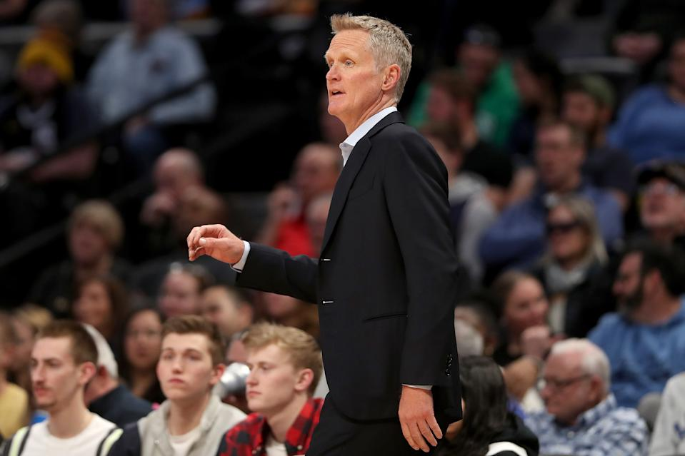 Golden State Warriors coach Steve Kerr works the sidelines in the first quarter of their game against the Denver Nuggets at the Pepsi Center on March 03, 2020, in Denver, Colorado.