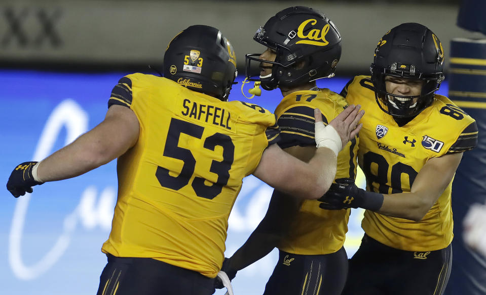 California's Makai Polk, center, celebrates with Michael Saffell (53) and Trevon Clark, right, after scoring a touchdown in the second half of an NCAA college football game against Arizona State, Saturday, Nov. 9, 2019, in Berkeley, Calif. (AP Photo/Ben Margot)