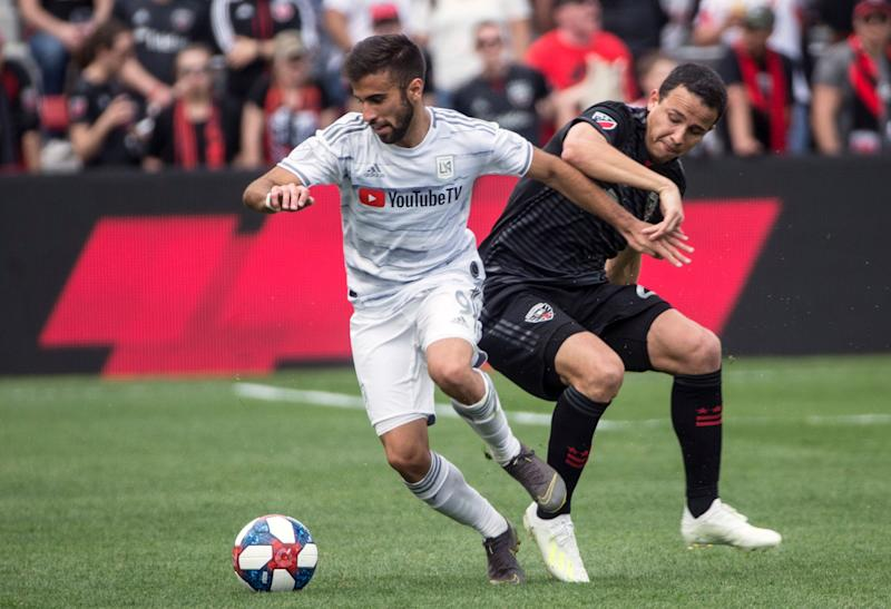 WASHINGTON, DC - APRIL 06: Los Angeles FC forward Diego Rossi (9) turns from DC United defender Leonardo Jara (29) during a MLS match between D.C United and Los Angeles FC on April 6, 2019, at Audi Field, in Washington D.C. (Photo by Tony Quinn/Icon Sportswire via Getty Images)