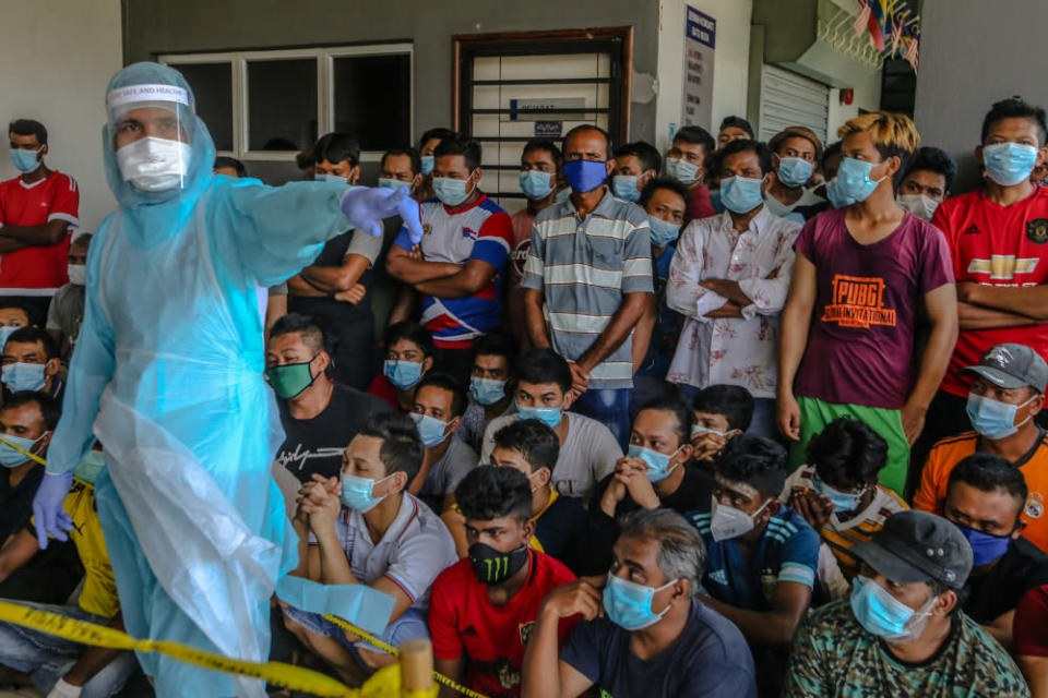 Foreign workers are seen during Covid-19 testing in Kuala Lumpur April 12, 2020. Dapsy's Chiong said legalising undocumented migrants during the immunisation drive would also enable the government to track the vaccine's efficacy.  — Picture by Firdaus Latif