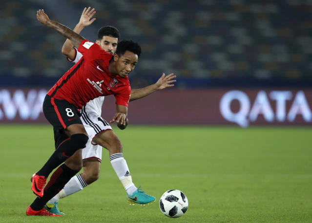 Japan's Urawa Reds Rafael Silva, left, challenges for the ball with Al Jazira's Mark Boussoufa during the Club World Cup soccer match between Al Jazira Club and Urawa Reds at Zayed sport city in Abu Dhabi, United Arab Emirates, Saturday, Dec. 9, 2017. (AP Photo/Hassan Ammar)