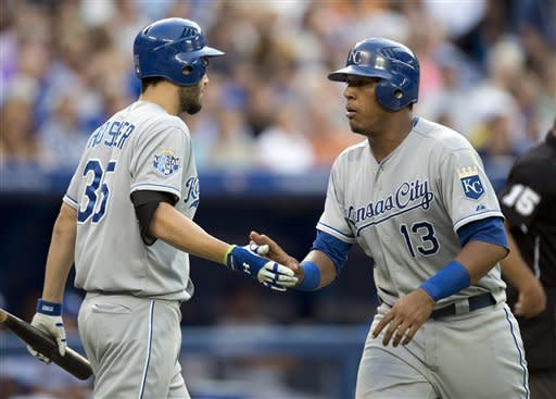 Kansas City Royals Salvador Perez (right) is congratulated by teammate Eric Hosmer after scoring during the third inning of a baseball game in Toronto on Thursday, July 5, 2012. (AP Photo/The Canadian Press, Frank Gunn)