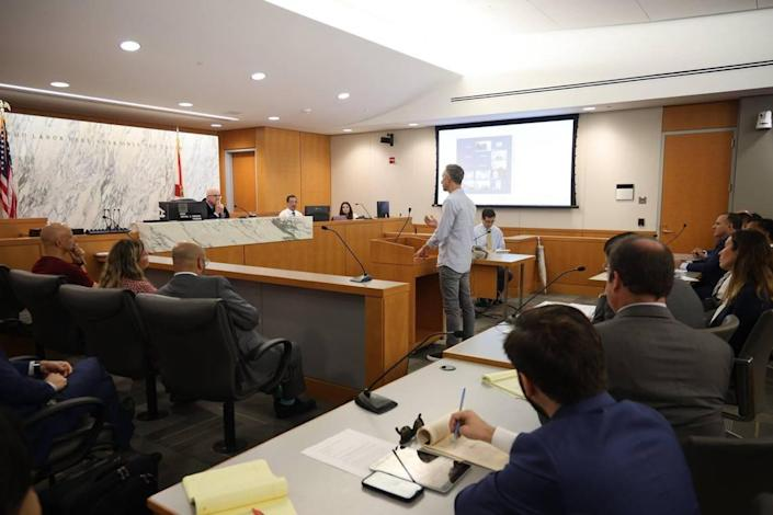 Oren Cytrynbaum, center, a victim of the Champlain Towers South collapse, speaks to Judge Michael Hanzman about his wishes for the future site. The Miami-Dade circuit judge presided over the status hearing for the Surfside condo collapse litigation with residents and their lawyers, along with the condo association's legal representatives.