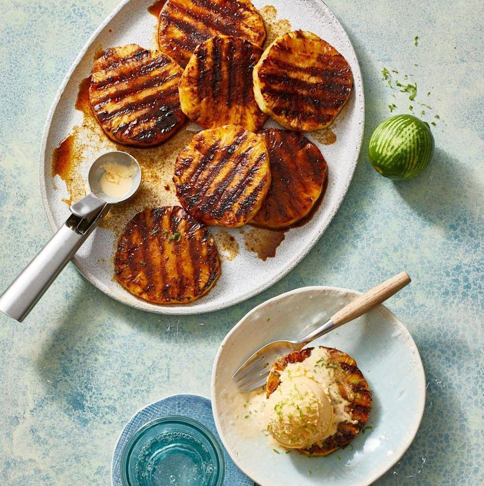 """<p>Juicy pineapple dipped in coconut sugar and cinnamon, then grilled until golden and caramelized, is the perfect start-of-summer dessert.</p><p><em><a href=""""https://www.goodhousekeeping.com/food-recipes/dessert/a31915070/grilled-pineapple-recipe/"""" rel=""""nofollow noopener"""" target=""""_blank"""" data-ylk=""""slk:Get the recipe for Grilled Pineapple »"""" class=""""link rapid-noclick-resp"""">Get the recipe for Grilled Pineapple »</a></em></p><p><strong>RELATED: </strong><a href=""""https://www.goodhousekeeping.com/food-recipes/cooking/tips/g1935/cut-whole-pineapple/"""" rel=""""nofollow noopener"""" target=""""_blank"""" data-ylk=""""slk:How to Cut a Pineapple in a Few Easy Steps"""" class=""""link rapid-noclick-resp"""">How to Cut a Pineapple in a Few Easy Steps</a><br></p>"""