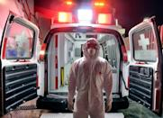 On top of the emotional stress paramedics must deal with the physical toll and discomfort of wearing a protective suit for hours