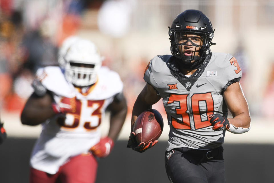 Chuba Hubbard (30) scores a touchdown during the first half of an NCAA college football game against Iowa State Saturday, Oct. 24, 2020, in Stillwater, Okla. (AP Photo/Brody Schmidt)