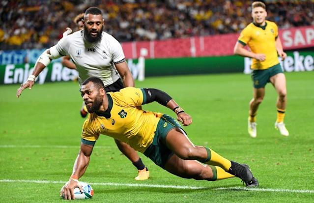 <span>Samu Kerevi goes over for an Australia try in Sapporo.</span> <span>Photograph: William West/AFP/Getty Images</span>