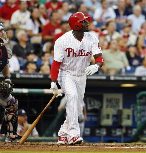 Philadelphia Phillies' Ryan Howard watches his two-run home run against the Atlanta Braves in the first inning of a baseball game, Tuesday, Aug. 7, 2012, in Philadelphia. (AP Photo/H. Rumph Jr)
