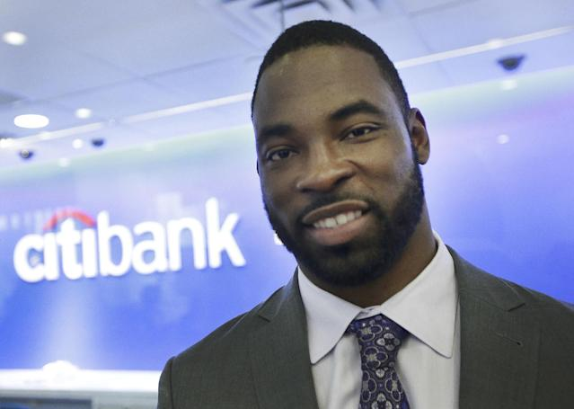 IMAGE DISTRIBUTED FOR CITIBANK - Superbowl Champion Justin Tuck visits Citibank branches on and around Super Bowl Boulevard before the Super Bowl to sign autographs and take photos with Citibank customers in New York, Friday, Jan. 31, 2014. Tuck will also co-host the Citi Super ProCamp V at Yankee Stadium tomorrow for youth grades 1-8, benefiting the Teammates for Kids Foundation. (AJ Mast /AP Images for Citibank)