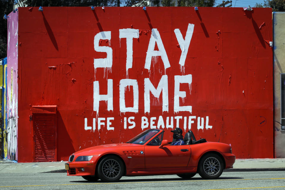"""A mural reads """"Stay Home, Life is Beautiful' Tuesday, April 14, 2020, in Los Angeles. (AP Photo/Marcio Jose Sanchez)"""