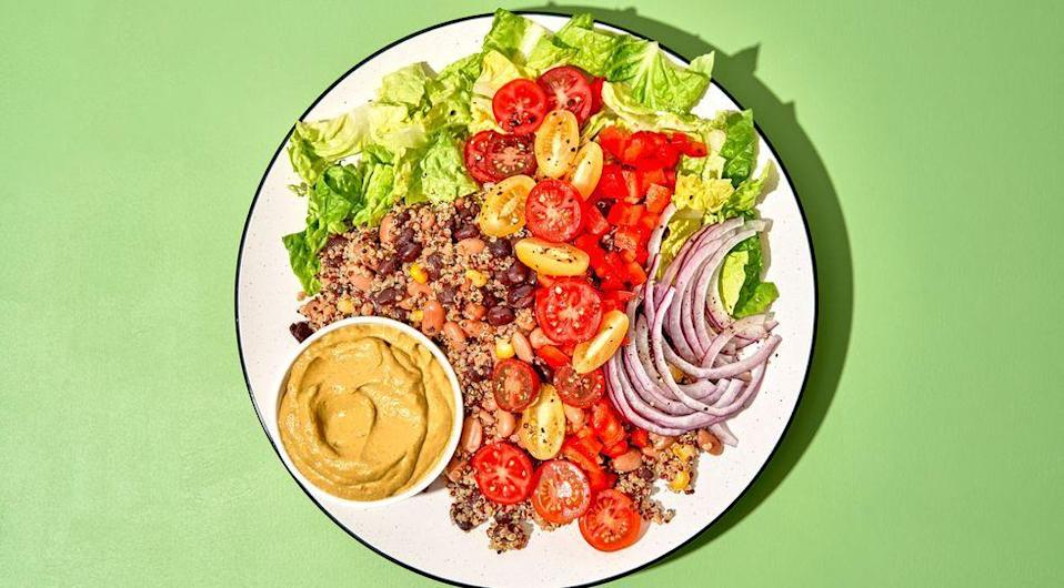 """<p>Our favourite <a href=""""https://www.delish.com/uk/cooking/recipes/a35427287/beef-taco-salad-recipe/"""" rel=""""nofollow noopener"""" target=""""_blank"""" data-ylk=""""slk:taco salad"""" class=""""link rapid-noclick-resp"""">taco salad</a> got a vegan makeover. Filled with grains and two different types of beans, it's a filling salad worthy of your dinner table. The spicy dressing brings tons of flavour and is our favourite part of the salad. Top it will all of your favourites like cherry tomatoes and tortilla chips for a little crunch! </p><p>Get the <a href=""""https://www.delish.com/uk/cooking/recipes/a35467323/vegan-taco-salad-recipe/"""" rel=""""nofollow noopener"""" target=""""_blank"""" data-ylk=""""slk:Vegan Taco Salad"""" class=""""link rapid-noclick-resp"""">Vegan Taco Salad</a> recipe.</p>"""