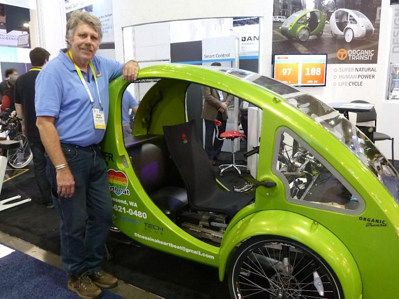 Craig Sparks of Organic Transport shows the Elf solar- and pedal-powered vehicle touted as the world's most environmentally friendly form of transport at the Consumer Electronics Show  on January 7, 2016 in Las Vegas, Nevada