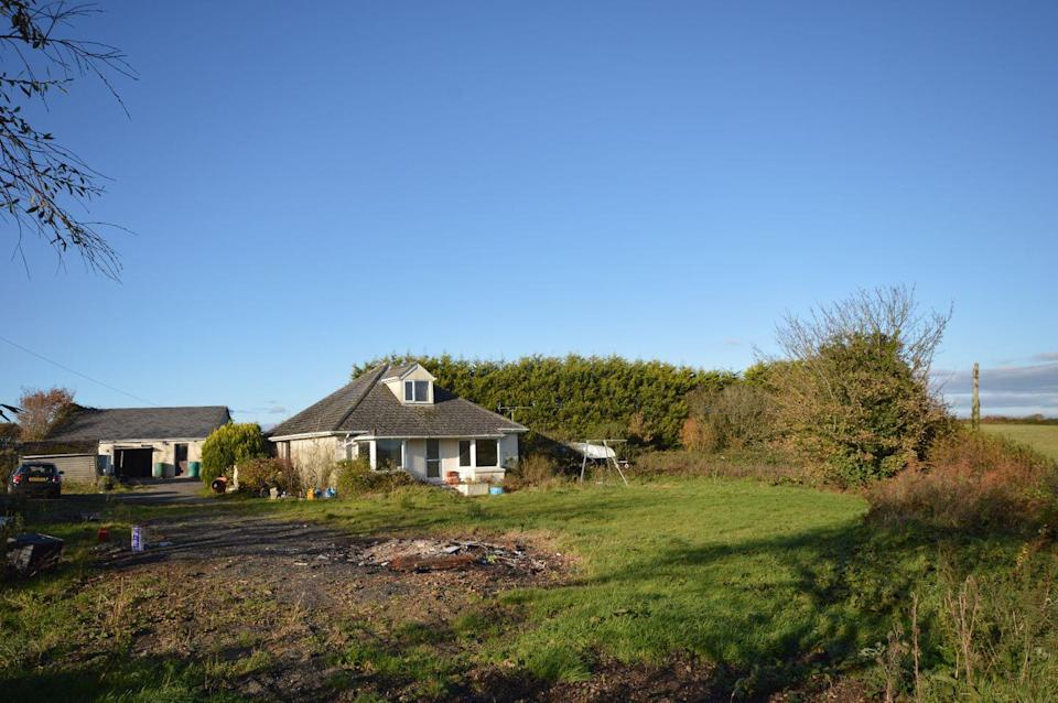 """<p>Situated in the heart of West Devon, this three-bedroom bungalow is the perfect adobe for those looking for a little project. It might be in a beautiful location, but the interiors are in desperate need of a refurb. Tempted? </p><p><a href=""""https://www.onthemarket.com/details/9578410/"""" rel=""""nofollow noopener"""" target=""""_blank"""" data-ylk=""""slk:This property is on the market for £325,000 with Godfrey Short & Squire at OnTheMarket"""" class=""""link rapid-noclick-resp"""">This property is on the market for £325,000 with Godfrey Short & Squire at OnTheMarket</a></p>"""