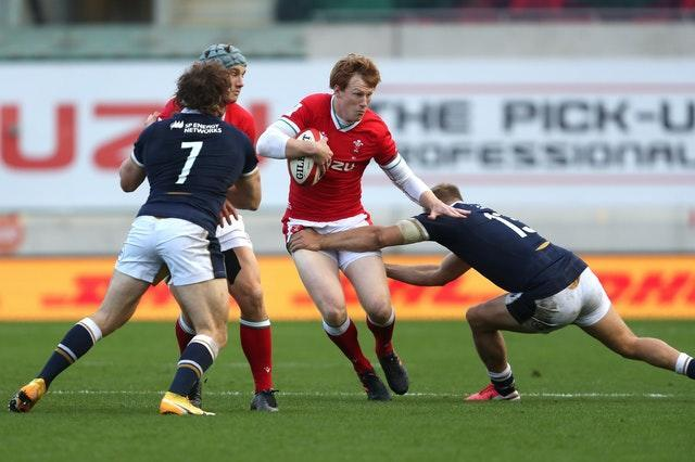 Harris puts in a tackle on Rhys Patchell during the Six Nations match at Parc y Scarlets