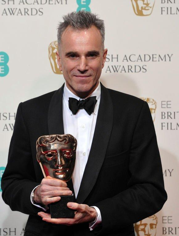 British actor Daniel Day-Lewis poses with the award for best leading actor for his performance in the film Lincoln during the annual BAFTA British Academy Film Awards at the Royal Opera House in London on February 10, 2013