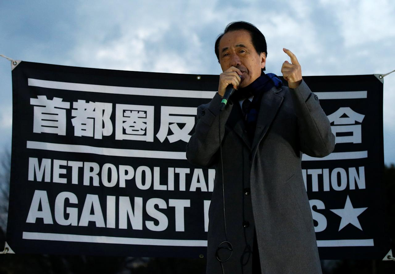 Former prime minister Naoto Kan delivers a speech during an anti-nuclear protest in front of the parliament building in Tokyo, Japan March 11, 2017, to mark the six-year anniversary of the March 11, 2011 earthquake and tsunami that killed thousands and set off a nuclear crisis. REUTERS/Toru Hanai